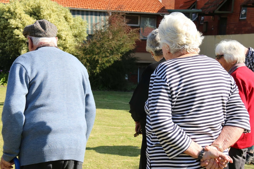 Generic photo of seniors, older people outside playing bowls can't see faces