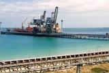 A ship is loaded at the Kwinana Bulk Terminal.