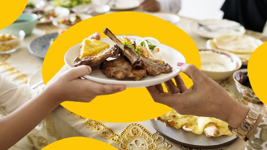 A close up shot of hands holding up plates of food during a Ramadan feast.