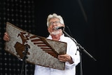 Rolf Harris performs with his wobble-board