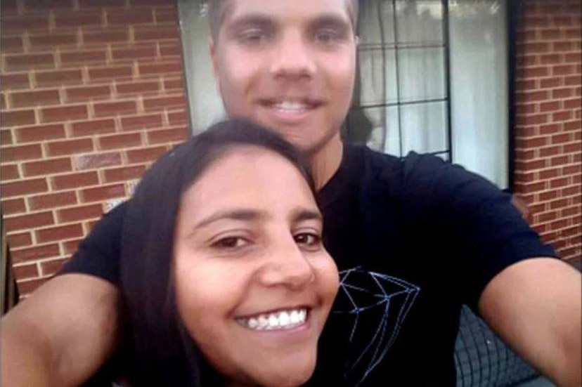 Stanley takes a selfie with his sister Jacinta Miller smiling and standing between his arms.