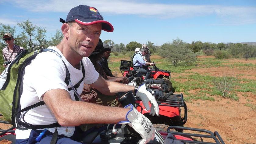 Tony Abbott on a quad bike