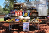 Picnic table covered in food donated by prisoners.