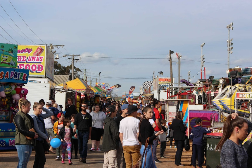 A crowd of people at an agricultural show