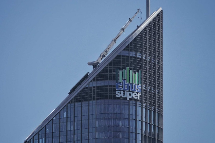 A tower has a sign at the top which says CBUS Super.