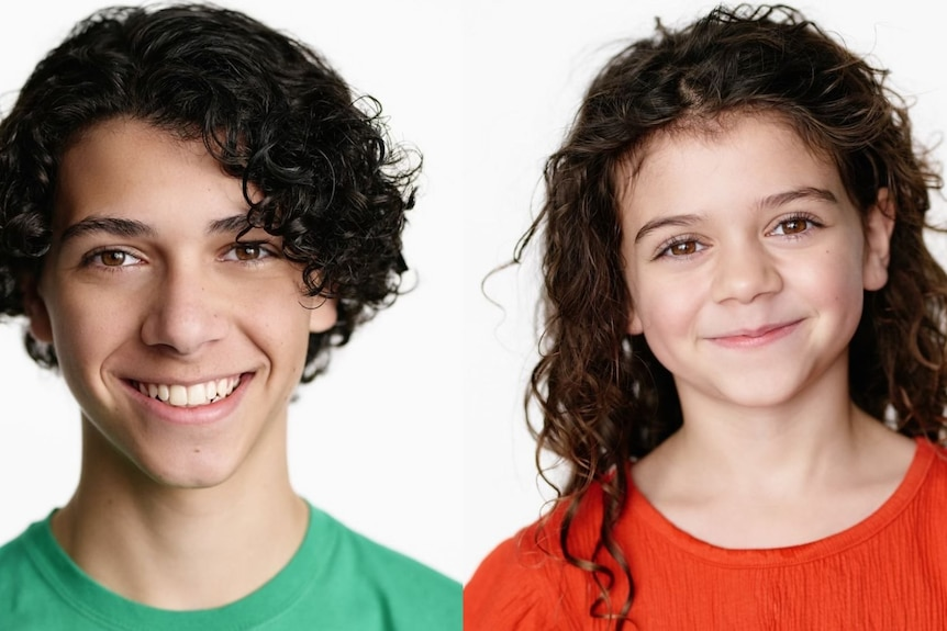Two children, one boy with brown hair in green shirt and girl with long brown hair in red shirt