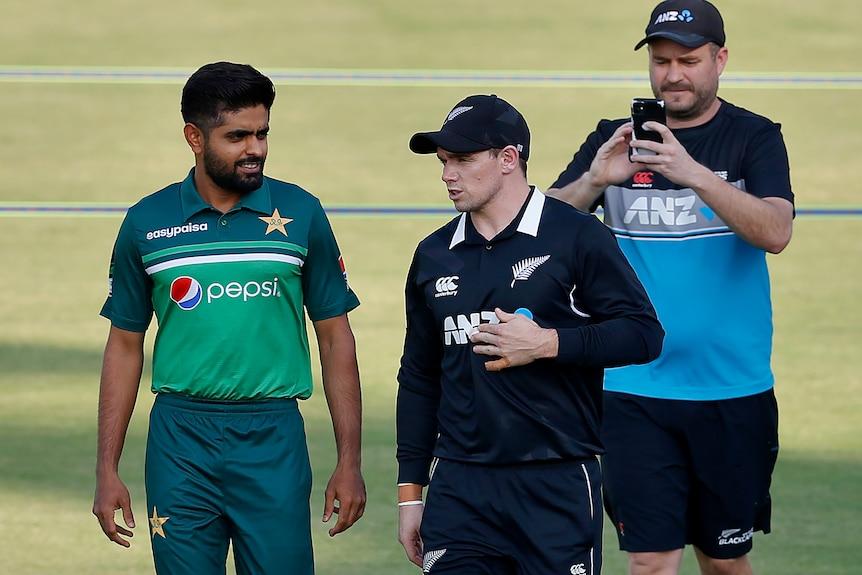 New Zealand and Pakistan skippers walk together at a cricket stadium in Rawalpindi, Pakistan, September 2021.
