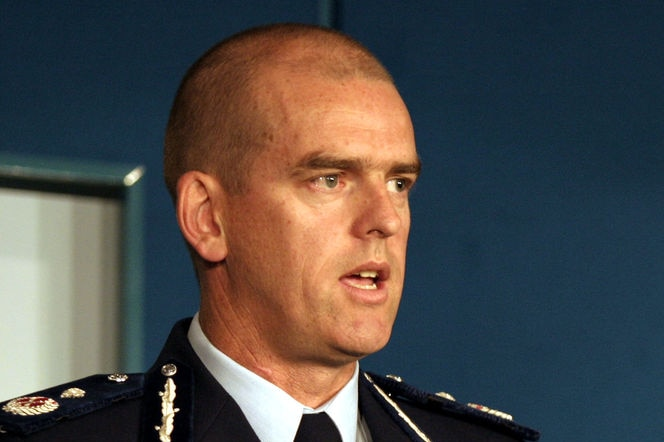 A head and shoulders shot of Simon Overland wearing a police uniform.