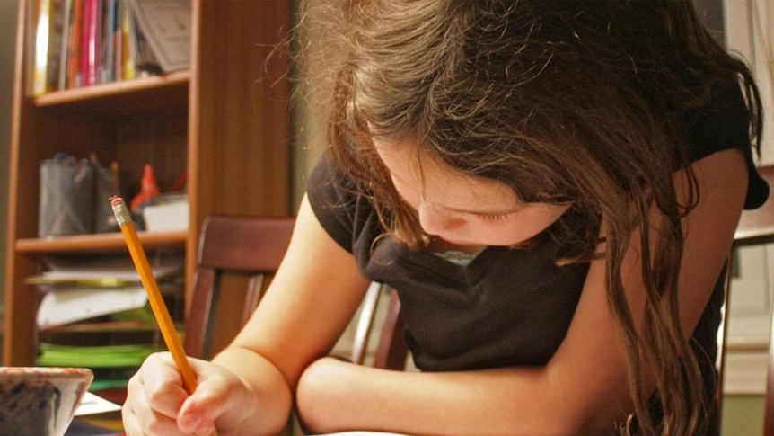 A child completes homework.