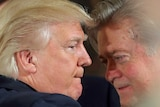 Donald Trump talks to Steve Bannon during a swearing in ceremony at the White House on January 22, 2017.