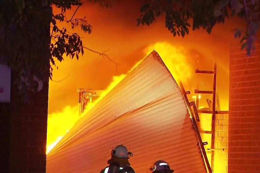 Part of a collapsed structure alight