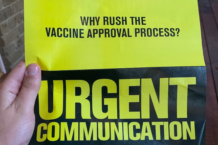 "Black and yellow flyer. In large block letters it says ""URGENT COMMUNICATION"""