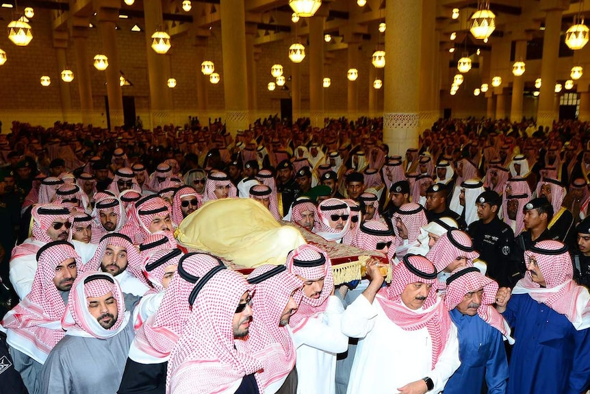 King Abdullah's body is carried during his funeral