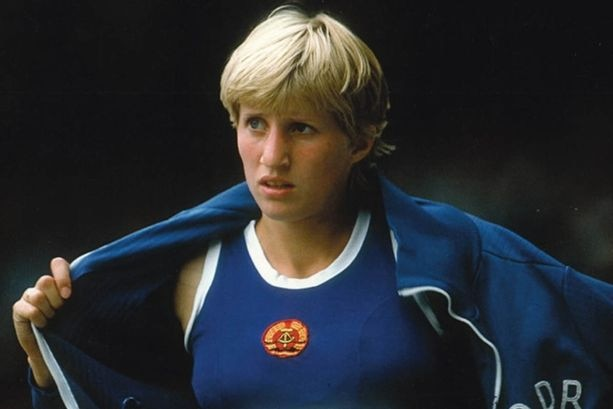 A photo of Ines Geipel as a young woman in her East German sport uniform.
