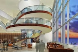 Artists impression of the Wrest Point refurbishment showing spiral stairs in the atrium with glass elevator.