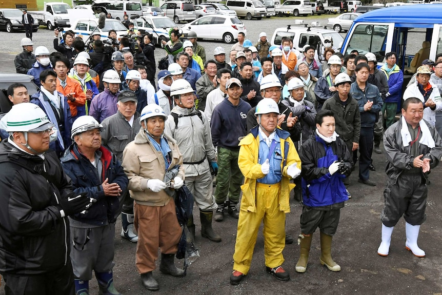 Rescuers celebrate after a seven-year-old missing Japanese boy is found alive.