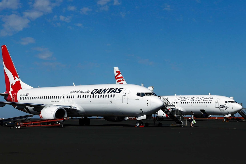 Qantas planes beside Virgin plane