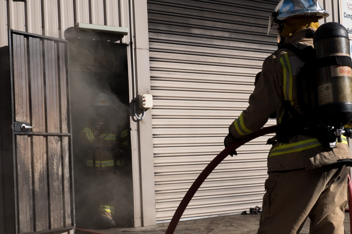 A student steps out of the smoke-filled room.