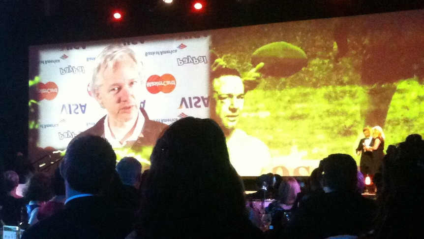 WikiLeaks founder Julian Assange accepts the award for most outstanding contribution to journalism