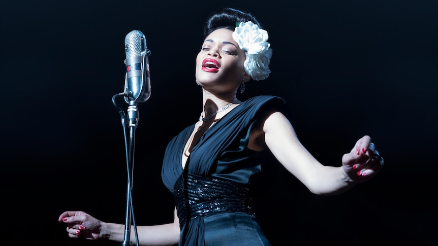 Film still of Andra Day as Billie Holliday singing on stage from The United States vs Billie Holiday