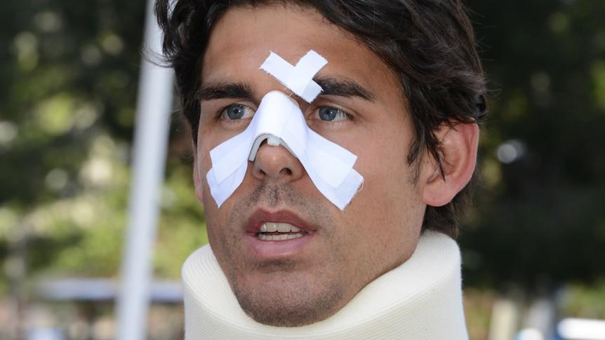 Tennis player Thomas Drouet, hitting partner of Bernard Tomic, with facial injuries, May 6 2013