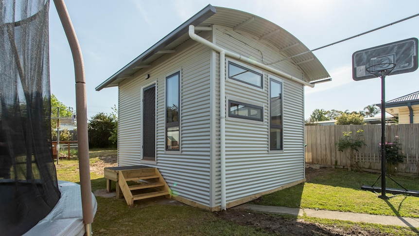 tiny house in a back yard