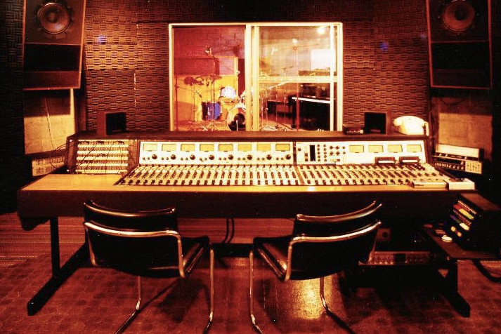 View of an audio mixing desk inside recording studio.