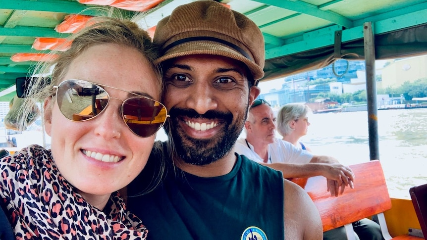 Cassie White and her partner on a boat in a story about what it's like to experience antenatal depression and anxiety.