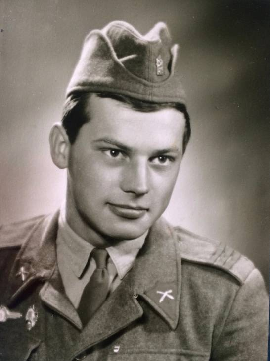A black and white portrait of a man in uniform.