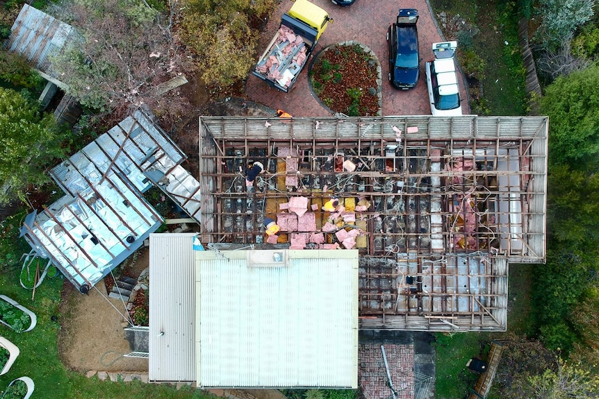 An aerial view of a house with the roof removed