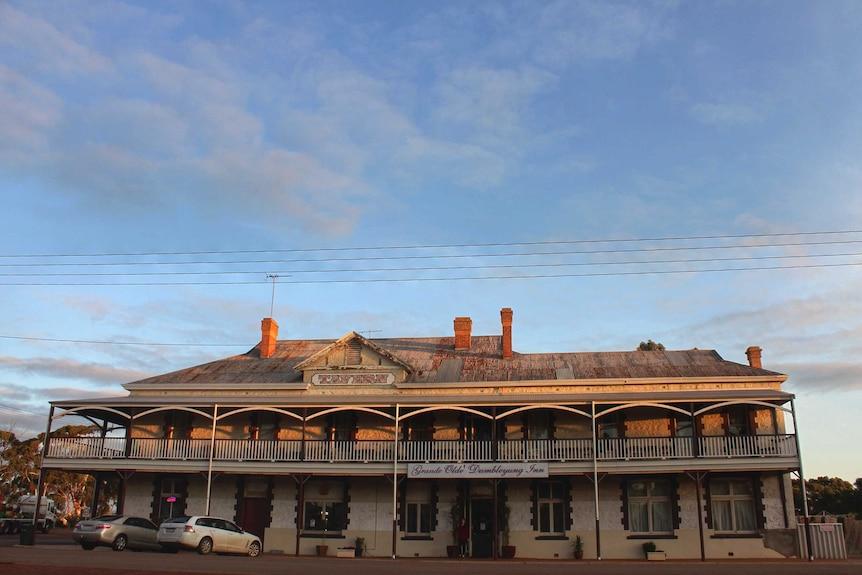 The sun is setting on a grand old Australian pub