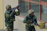 Kenyan soldiers move in formation outside the Westgate Mall in Nairobi.