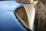 Water spill over a dam wall.