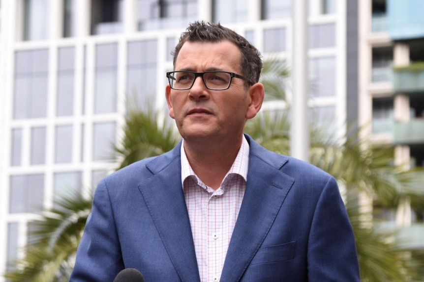 Daniel Andrews speaks to reporters.