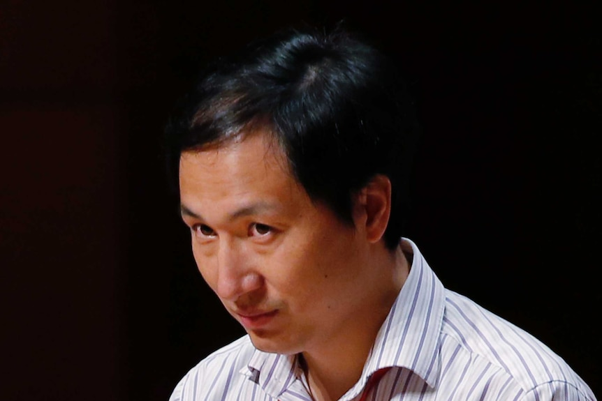 A head shot of Dr he speaking into a microphone.
