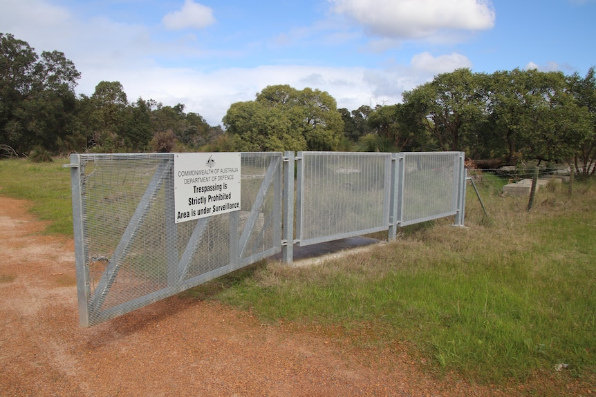A fence warning trespassers against entering Department of Defence land in Bullsbrook.
