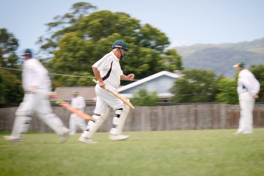Doug Crowell running on cricket pitch.