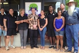 Helen Morton holds the 'baton of life' with Alive and Kicking team in Broome.jpg