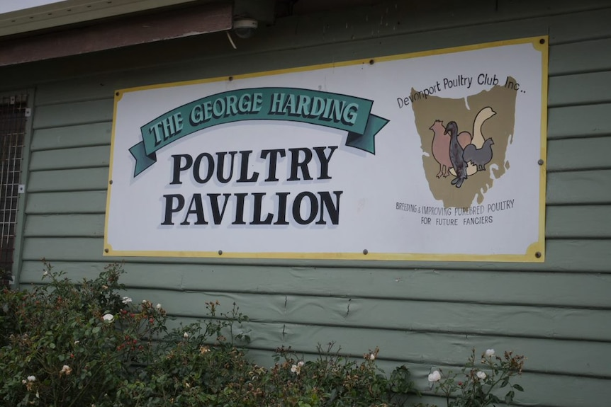 A sign reads The George Harding Poultry Pavillion