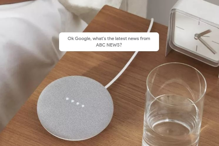 """A Google Home Mini sits on a bedside table and is asked """"What's the latest news from ABC News""""."""