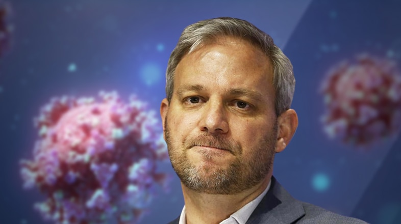 A graphic image of Chief Health Officer Brett Sutton in front of a coronavirus background.
