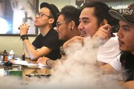 Young men vape in an inner-city vape bar in Jakarta, Indonesia