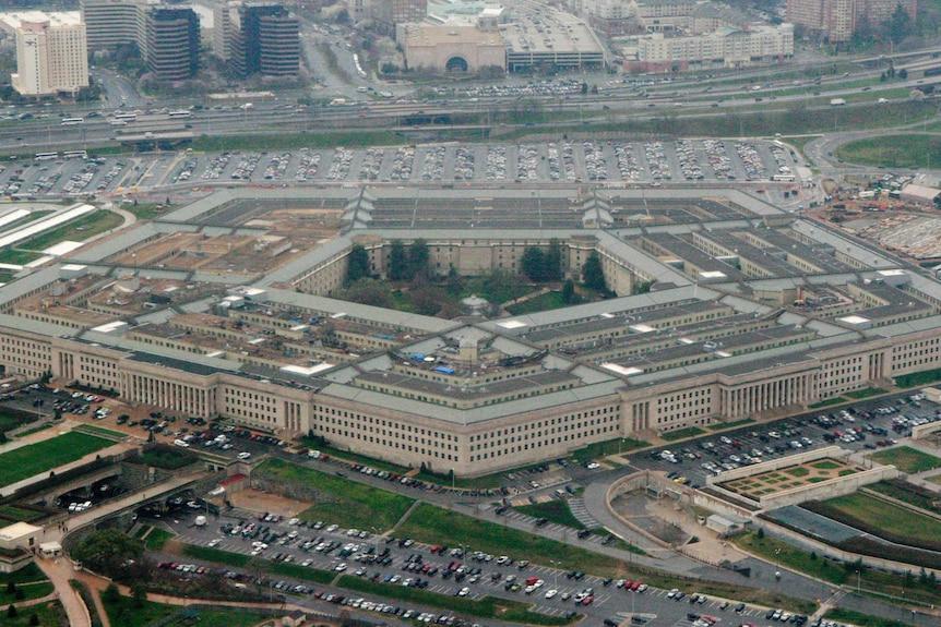An aerial shot shows the five-sided Pentagon building sitting near a major highway.