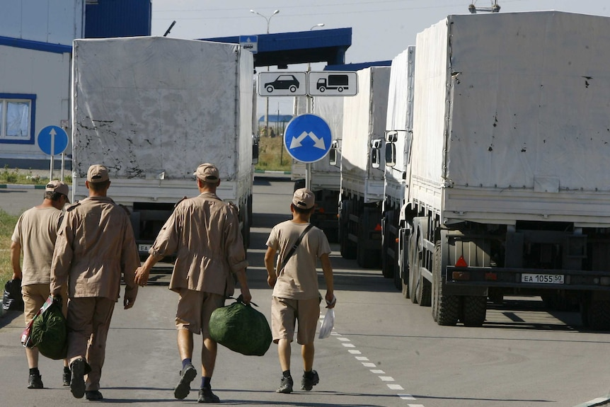 Drivers wait to leave with Russian convoy