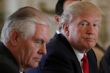 US President Donald Trump sitting next to Secretary of State Rex Tillerson in 2017.
