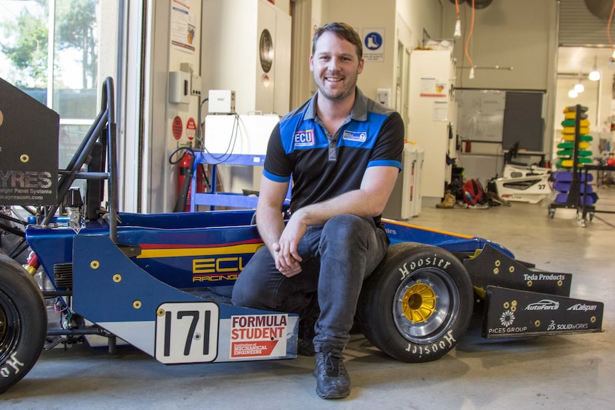Nathan Van Vugt with the car he and the team produced for Formula Student 2016.