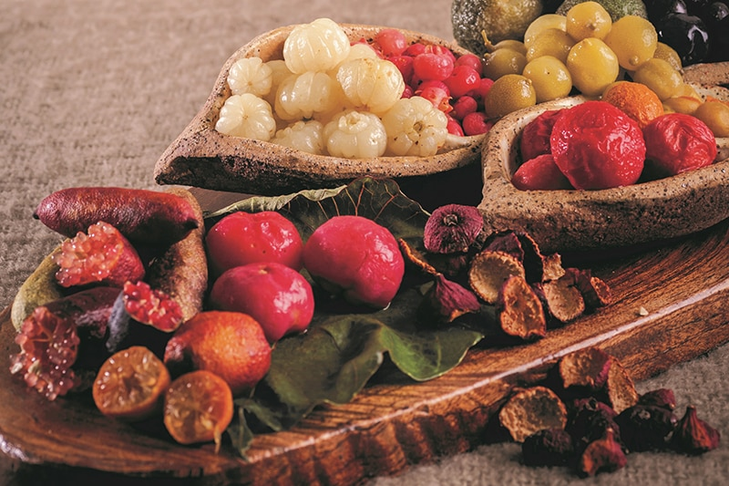 A platter covered in native fruit like finger limes and berries.