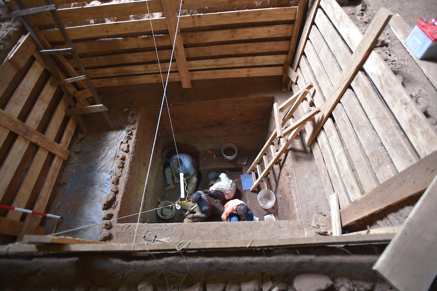 Researchers excavating a trench