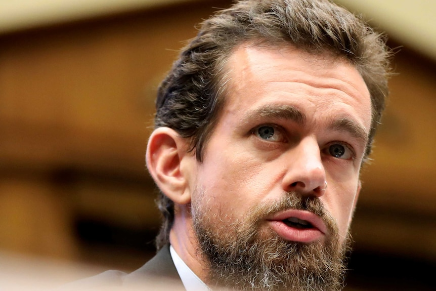 A close-up of Twitter CEO Jack Dorsey looking on in a committee room