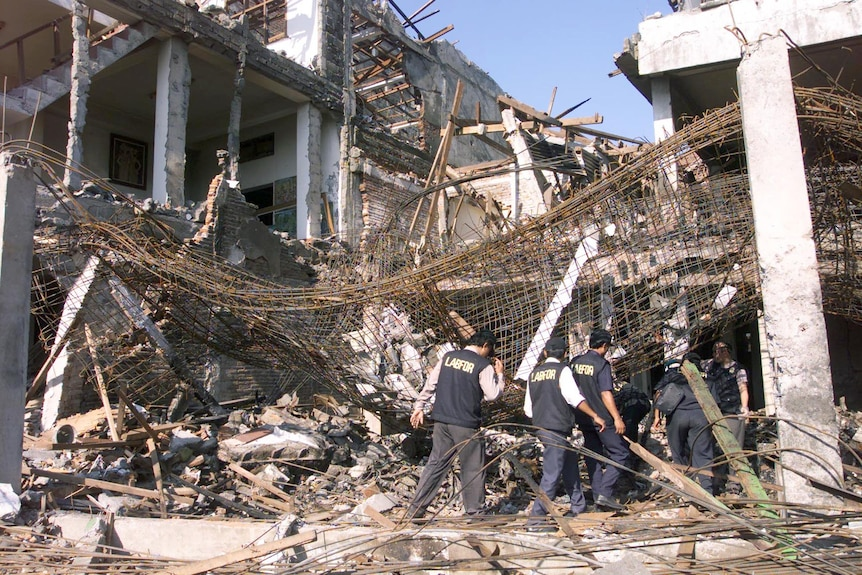 A building stands burnt out with its scaffolding exposed at the site of the bombing in Kuta beach, Bali, October 2003.
